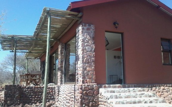 Waterberg accommodation with own private entrance leading out to a veranda.